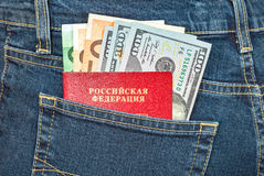 Russian passport, euro and dollar bills in the back jeans pocket Stock Photos