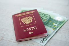 Russian passport lies on a pile of euro banknotes Stock Photography