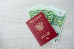Russian passport lies on a pile of euro banknotes Royalty Free Stock Photography
