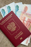 Russian passport with money Stock Image