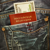 Russian passport and money in jeans pocket Royalty Free Stock Photography