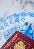 Russian passport and russian money on marbel background stock photo