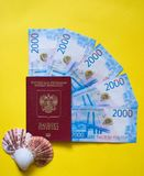 Russian passport and russian money on yellow background stock images