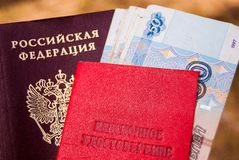 Russian passport, pension certificate and money-Russian translation: pension certificate royalty free stock image