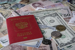 The Russian passport on a pile of  foreign currencies Stock Photos