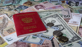 The Russian passport on a pile of  foreign currencies Stock Image
