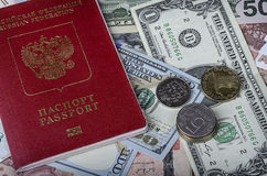 The Russian passport on a pile of  foreign currencies Royalty Free Stock Image