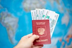 Russian passport with ruble banknotes on the background of the world map royalty free stock images