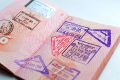 Russian passport stamped on border crossing. Departure and arrival immigration stamps. royalty free stock photo