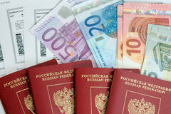 Russian passports, boarding pass and money Stock Images