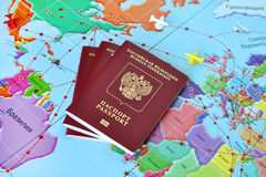 Russian passports. On world map background Stock Images