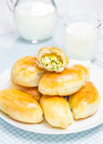 Russian pastries (pirogi) filled with eggs and green onion. Closeup Stock Image