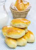 Russian pastries (pirogi) and milk. On wooden table Stock Photography