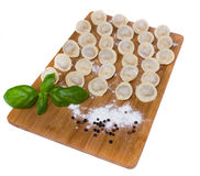 Russian pelmeni with basil and black pepper Royalty Free Stock Photography