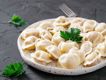 Russian pelmeni, ravioli, dumplings with meat Stock Photo