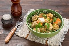 Russian pelmeni on table. Meat dumplings with pepper and butter on table. Pelmeni russian national dish Stock Photography