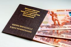 Russian pension certificate and currency. Banknotes.Russian translation - Ministry of Social Protection of Population of Russian Federation. Pension Certificate royalty free stock photography