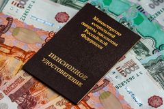 Russian pension certificate and currency. Banknotes.Russian translation - Ministry of Social Protection of Population of Russian Federation. Pension Certificate royalty free stock image