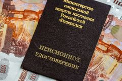 Russian pension certificate and currency. Banknotes.Russian translation - Ministry of Social Protection of Population of Russian Federation. Pension Certificate stock images