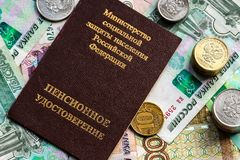 Russian pension certificate and currency. Banknotes and coins. Russian translation - Ministry of Social Protection of Population of Russian Federation. Pension royalty free stock image