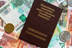 Russian pension certificate and currency. Banknotes and coins. Russian translation - Ministry of Social Protection of Population of Russian Federation. Pension royalty free stock photography