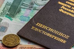 Russian pension certificate and currency. Banknotes and coins. Russian translation - Ministry of Social Protection of Population of Russian Federation. Pension stock photography