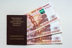 Russian pension certificate and currency. Banknotes.Russian translation - Ministry of Social Protection of Population of Russian Federation. Pension Certificate royalty free stock photos