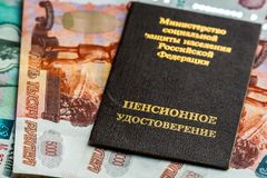 Russian pension certificate and currency. Banknotes.Russian translation - Ministry of Social Protection of Population of Russian Federation. Pension Certificate stock photography