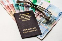Russian pension certificate, glasses and russian rubles banknotes stock image