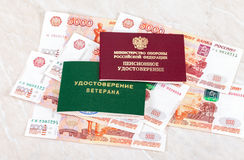 Russian Pension Certificate and Veteran Certificate lying over b Stock Photo