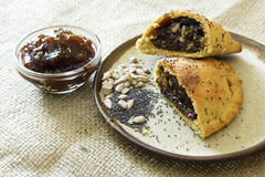 Russian pirozhki, baked patties or pies on basket Royalty Free Stock Photos