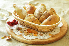 Russian pirozhki, baked patties or pies on basket Royalty Free Stock Photography