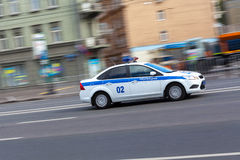 Russian police car. A police car fast rides on the empty road stock photos