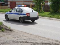 Russian police car with flashing lights.  Royalty Free Stock Photo