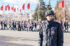 Russian police officer in uniform standing in the cordon. SAMARA, RUSSIA - NOVEMBER 7, 2015: Russian police officer in uniform standing in the cordon during the Royalty Free Stock Images