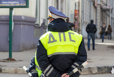 Russian police officers standing by the road in lime-colored uni Stock Images