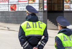 Russian police officers standing by the road in lime-colored uni Royalty Free Stock Images