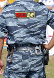 Russian policeman. Russian militia changes its name to police from March of this year (the label is a photoshop image stock images