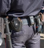 Russian policeman with gun belt, handcuffs gun, shoker and holst. Samara, Russia - May 5, 2018: Russian policeman with gun belt, handcuffs gun, shoker and stock image
