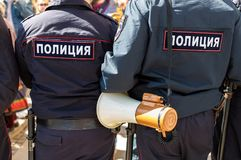 Russian policeman with megaphone speaker. Samara, Russia - May 5, 2018: Russian policeman with megaphone speaker during an opposition protest rally. Text in stock photography