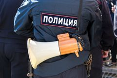 Russian policeman with megaphone speaker. Samara, Russia - May 5, 2018: Russian policeman with megaphone speaker. Text in russian: Police stock image