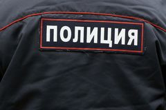 Russian policeman`s back close up with an emblem. Russian policeman`s back wearing an uniform close up with an emblem Police royalty free stock images
