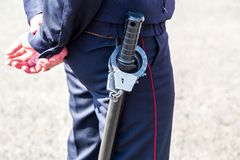 Russian policeman with truncheon and handcuffs. Russian policeman with rubber truncheon and steel handcuffs royalty free stock photo