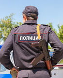 Russian policeman in uniform with automatic rifle. SAMARA, RUSSIA - MAY 31, 2014: Russian policeman in uniform with automatic rifle. Text in russian: Police royalty free stock photography