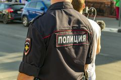Russian policeman in uniform with a patch on the street,. Close-up view from the back stock photos