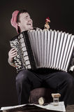 Russian poor man with an accordion and vodka Stock Photo