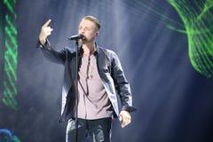 Russian pop singer Egor Kreed performs during the 25th Slavyansky Bazar Festival. VITEBSK, BELARUS - JULY 17: Russian pop singer Egor Kreed performs during the Stock Image