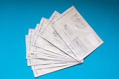 Russian post polyethylene envelope on blue background. Plastic Postal Mailing Bags stock images