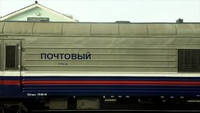 Russian post train slowly moving. Across the station Ulanskaya in Syberia stock video