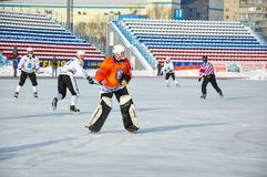 Game of bandy. Russian Premier League match ball hockey:  Lokomotiv  Orenburg  Universal  Saratov. 12.01.2013, city of Orenburg, Southern Ural, Russia Stock Image